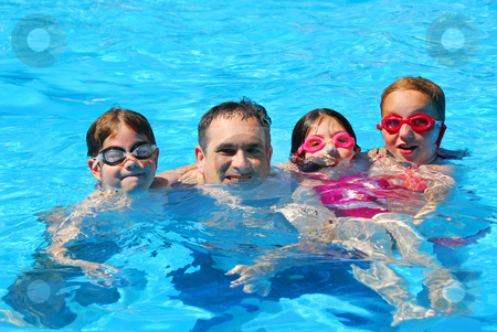 Happy family pool stock photo, Happy family in a swimming pool by Elena Elisseeva