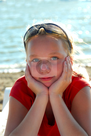Girl beach relax stock photo, Portrait of a beautiful young girl on a beach by Elena Elisseeva