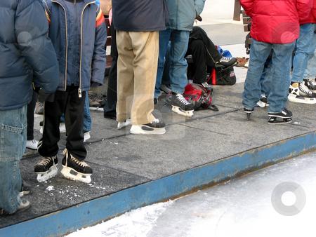 Skating rink stock photo, People wearing skates standing near skating rink by Elena Elisseeva