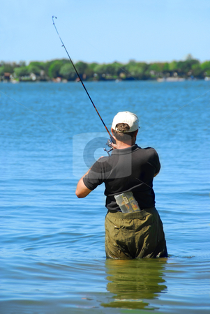 Fisherman stock photo, Man fishing in a lake standing in water by Elena Elisseeva