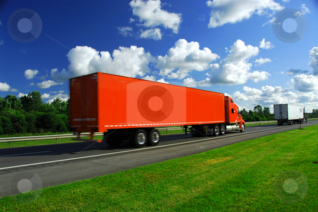 Truck speed highway stock photo, Bright red truck on road, blurred because of fast motion by Elena Elisseeva