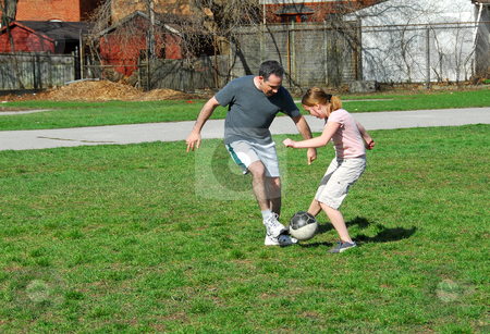 Playing soccer stock photo, Family playing soccer by Elena Elisseeva