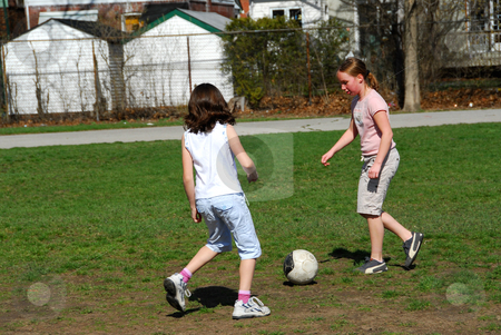 Girls playing soccer stock photo, Young girls playing soccer by Elena Elisseeva