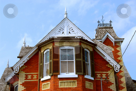 Victorian house stock photo, Fragment of a beautiful red brick victorian house by Elena Elisseeva