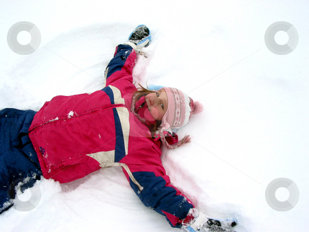 Snow angel stock photo, Young girl making a snow angel on fresh white snow by Elena Elisseeva