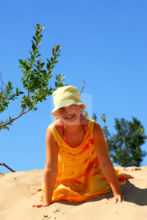 Girl beach stock photo, Young girl sitting on top of a sand dune by Elena Elisseeva