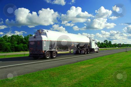 Speeding truck gasoline stock photo, Speeding truck delivering gasoline on highway blurred because of motion by Elena Elisseeva