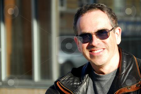 Man in sunglasses stock photo, Smiling man in sunglasses by Elena Elisseeva