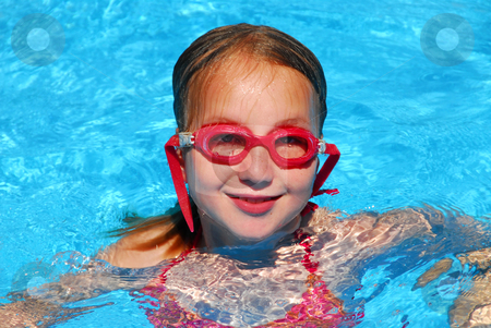 Girl swim pool stock photo, Young girl in red goggles in a swimming pool by Elena Elisseeva