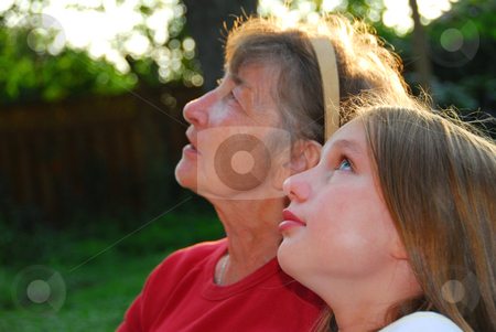 Generations stock photo, Portrait of a grandmother and granddaughter looking up with hope by Elena Elisseeva