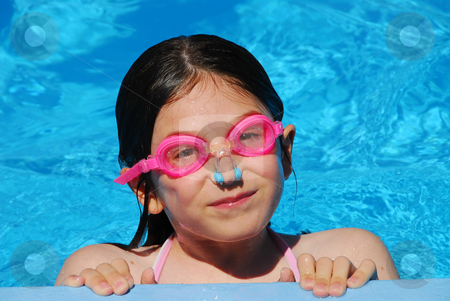 Girl child pool stock photo, Portrait of a smiling girl in pink goggles in a swimming pool by Elena Elisseeva