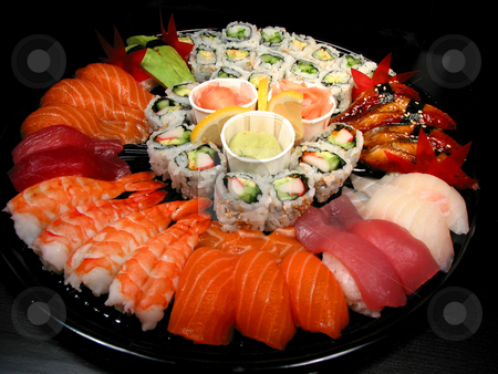 Sushi party tray stock photo, Party tray of sushi and rolls by Elena Elisseeva