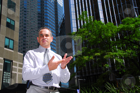 Businessman talking stock photo, Businessman explaining an idea downtown by Elena Elisseeva