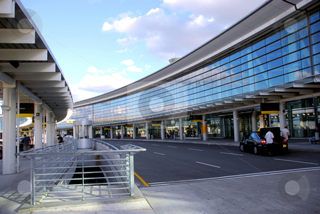 Terminal stock photo, Airport terminal with cars outside and bright blue sky by Elena Elisseeva