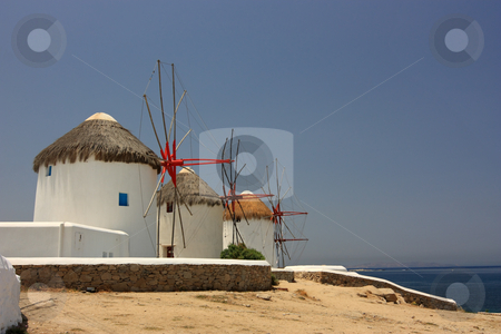 Mykonos Windmills stock photo, Three of the famous windmills in Mykonos island, Greece by Georgios Alexandris