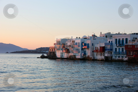 Mykonos at Sunset stock photo, A view of the Mykonos town during the hours of sunset by Georgios Alexandris