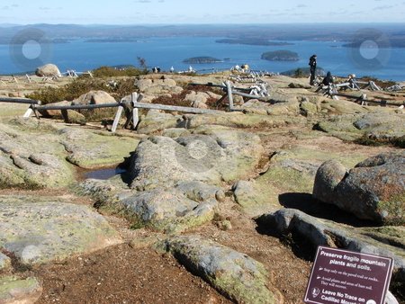 Cadillac Mountain Summit stock photo, Cadillac Mountain on Mount Desert Isle in Acadia National Park near Bar Harbor, Maine is the tallest mountain (1,528) bordering the eastern seaboard and easily accessible  by car for tourists. This vantage point is from the summit looking east toward the Atlantic.  Breath taking views abound in this national park. by Dennis Thomsen