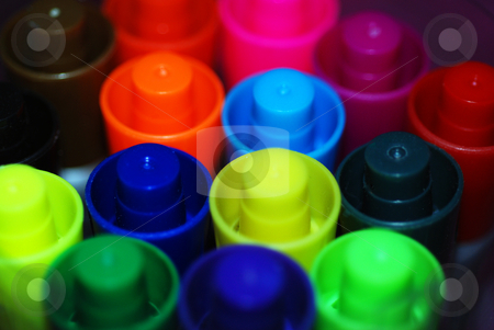 Coloured Pen Lids stock photo, A macro photograph of a group of brightly colored pen lids by Philippa Willitts