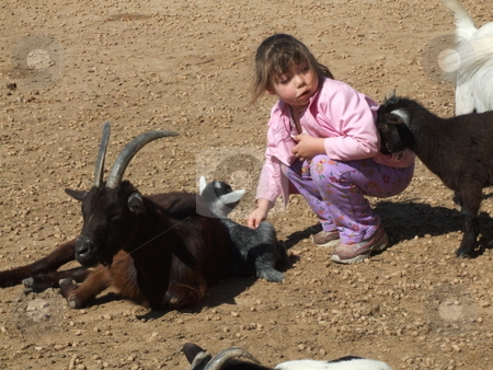 Kids stock photo, Youngsters playing together.  Child petting kid while another kid headbutts her from behind by Marburg