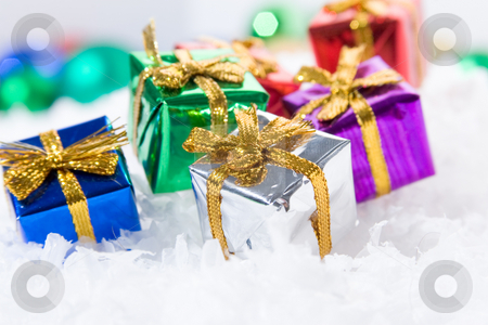 Presents in snow stock photo, Gift wrapped presents in snow with wrapping paper and bowties. by Jose Wilson Araujo