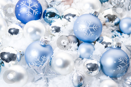 Christmas ornaments stock photo, Christmas ornaments that are white and blue and covered in snow by Jose Wilson Araujo