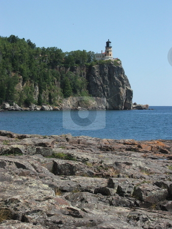Split Rock Lighthouse stock photo, Split Rock Lighthouse is Minnesota's most famous lighthouse and sits high on top of a rocky cliff above the northern Lake Superior shoreline.  Thousands of tourists visit Split Rock and the state park yearly. by Dennis Thomsen
