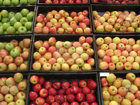 Farm fresh stock photo, Stacks of fresh, juicy and deliciously looking apples are neatly displayed inside bins at a farmers market. by Rebecca Mosoetsa