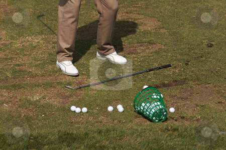 Golfer At The Range stock photo, Golfer Practicing His Swing At The Range by Andy Dean