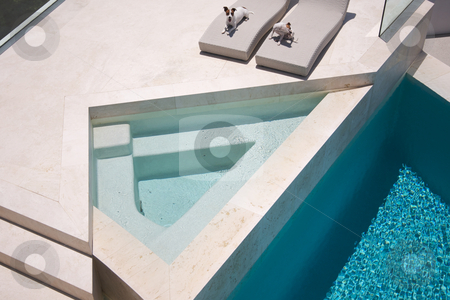 JRTs Enjoying Custom Luxury Pool stock photo, Custom Luxury Pool and Chairs Abstract with two JRTs relaxing. by Andy Dean