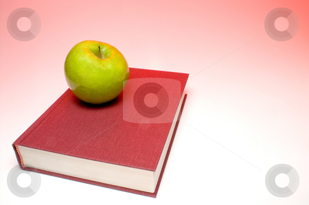 Back to School stock photo, Back to School Concept- An apple on a book. by Robert Byron