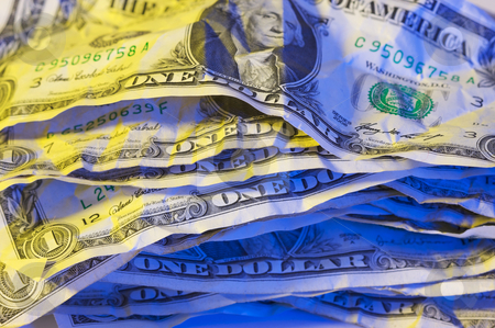 Pile of Crumpled Dollar Bills. stock photo, Pile of Crumpled One Dollar Bills. by Andy Dean