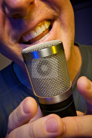 Vocalist crooning Microphone stock photo, Passionate Vocalist & Microphone by Andy Dean