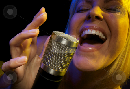 Woman Sings with Passion stock photo, Woman with Microphone Sings with Passion by Andy Dean