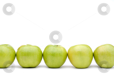 Fresh green apples stock photo, Green apples line up on a white background by Vince Clements