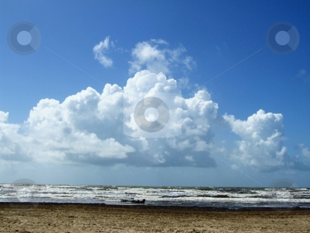 Beach  stock photo, The sand, surf and sky appear pancaked during a clear summer day by Marburg