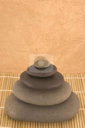 Four Massage Stones stock photo, Four Massage Stone Stack by Ariana Bauer