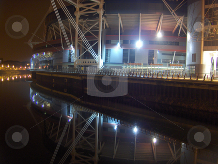 Cardiff at Night stock photo, A night shot of the sports arena lights reflected on the water in Cardiff, Wales.  Editorial only by Jessica Tooley