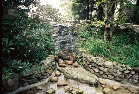 Rock Garden stock photo, Water flowing over rocks in a rock garden path by Marburg