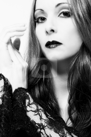 Curious gothic stock photo, Portrait of a woman in front of a white background in a studio enviroment by Frenk and Danielle Kaufmann