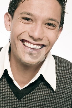 Indonesian young man smiling wide stock photo, Studio portrait of mixed race young man with a wide smile by Frenk and Danielle Kaufmann