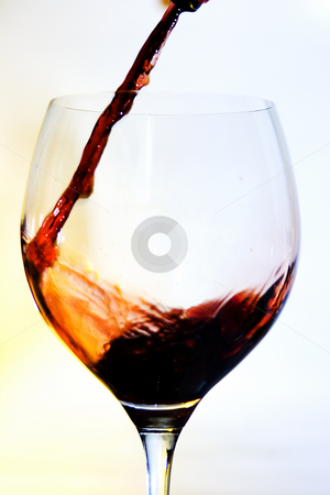 Red wine glass stock photo, Bottle and glass of red wine by Ivan Montero