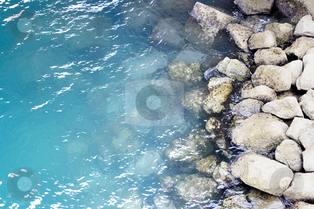 Water stock photo, The water of the sea and some rocks in the shore by Ivan Montero