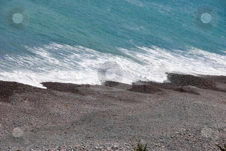 Shoreline stock photo, Stock photo of waves hitting a pebbly black beach by Maria Bell