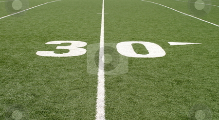 Football Field Thirty stock photo, Green football field with large yard numbers. by Henrik Lehnerer
