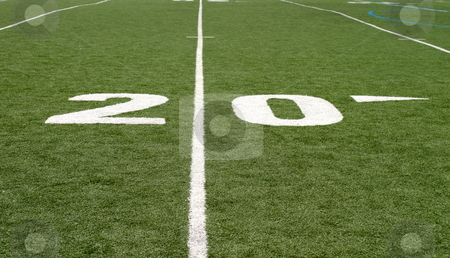 Football Field Twenty stock photo, Green football field with large yard numbers. by Henrik Lehnerer