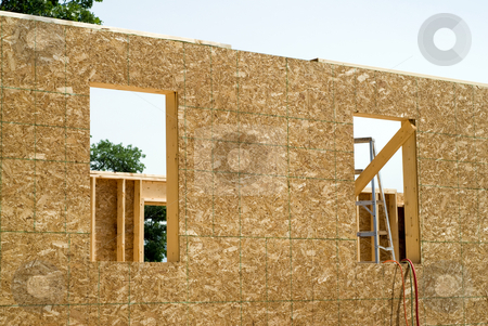 Construction stock photo, The outside of an unfinished building being constructed by Richard Nelson