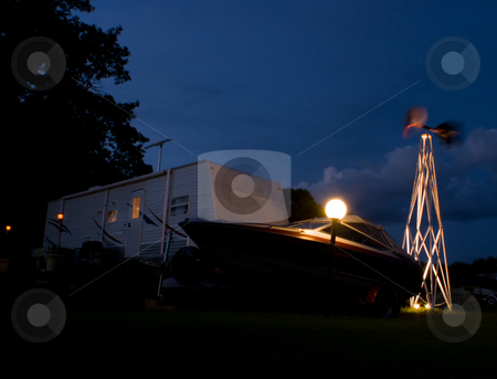 Camping stock photo, Night view of a camping trailer and boat by Richard Nelson