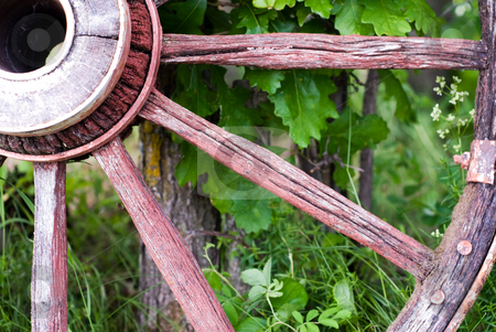 Close-up Wagon Wheel stock photo, Closeup view of a antique wagon wheel, located outside by Richard Nelson