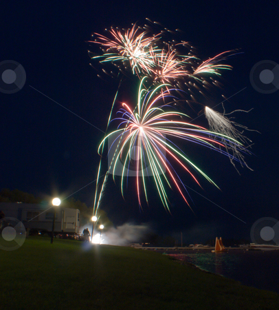 Fireworks stock photo, Fireworks shot over the water at a campground by Richard Nelson
