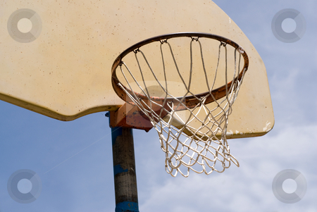 Basketball Net stock photo, Close-up view of a basketball net shot against a cloudy sky by Richard Nelson